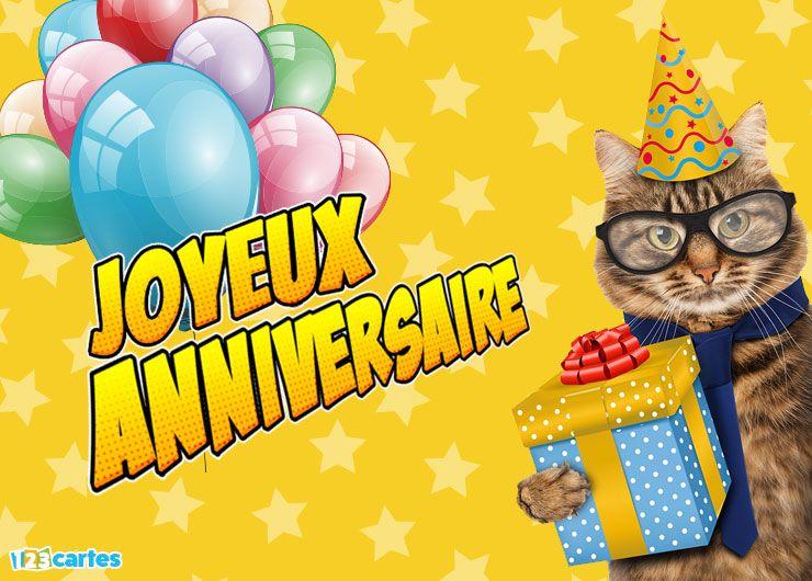 chat avec des lunettes et un chapeau pointu et qui tient dans sa patte une boîte cadeau
