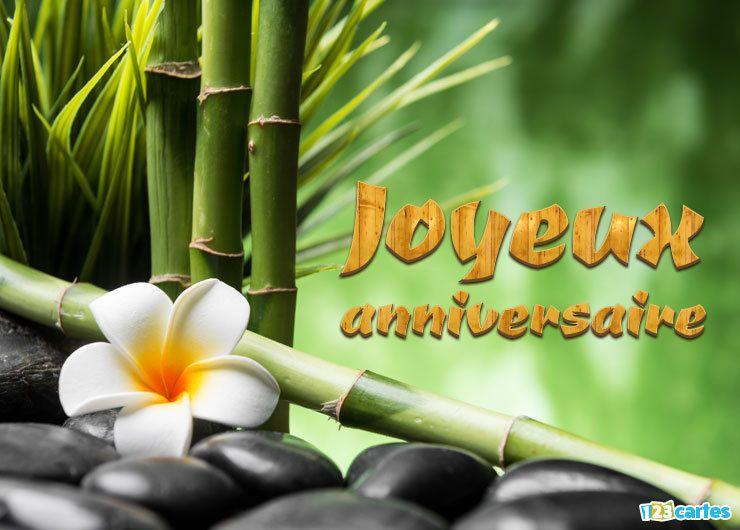 carte joyeux anniversaire fleur de frangipanier, bambous et pierres de basalte