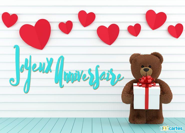 carte joyeux anniversaire ourson d'amour tenant une boîte cadeau blanche avec ruban rouge