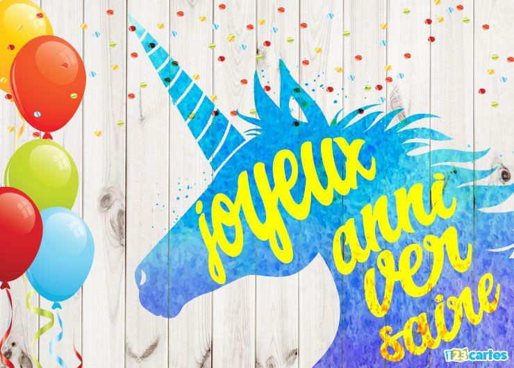 silhouette d'une licorne bleue sur palissade en bois, ballons gonflables et confettis