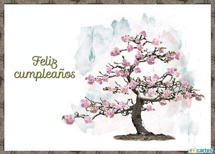 cerisier à fleurs roses avec joyeux anniversaire en Espagnol