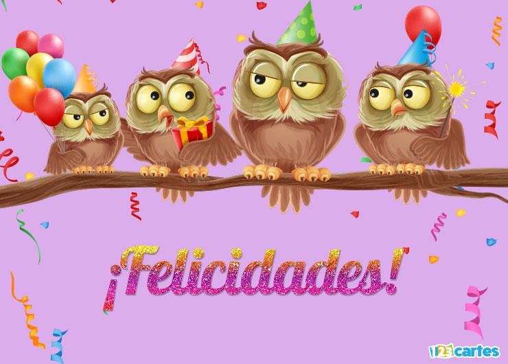 drôles d'hiboux sur une branche qui portent des chapeaux pointus des ballons gonflables et un cierge magique avec joyeux anniversaire en Felicidades Espagnol