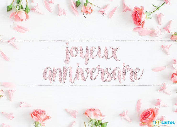 roses disposées autour du cadre sur des planches en bois et au milieu Joyeux anniversaire