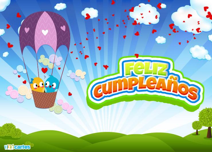 deux petits oiseaux amoureux dans une montgolfière avec joyeux anniversaire en Espagnol