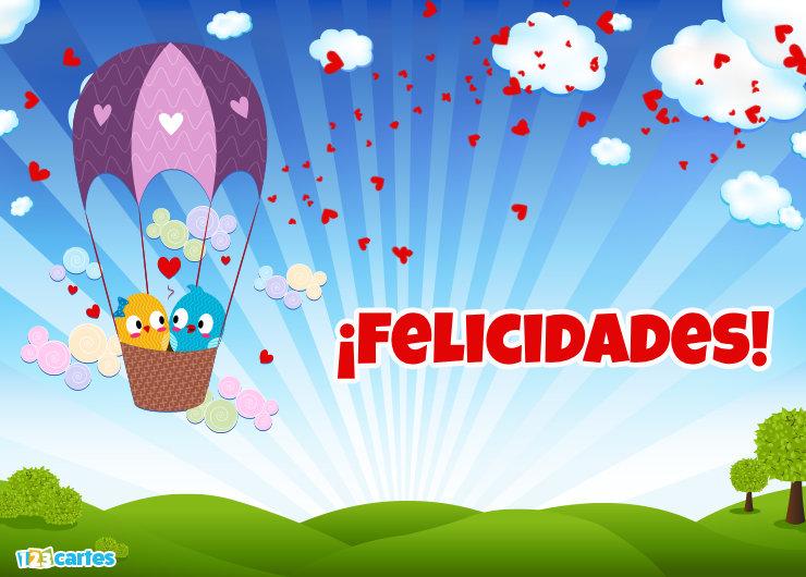 deux petits oiseaux amoureux dans une montgolfière avec joyeux anniversaire en Felicidades Espagnol