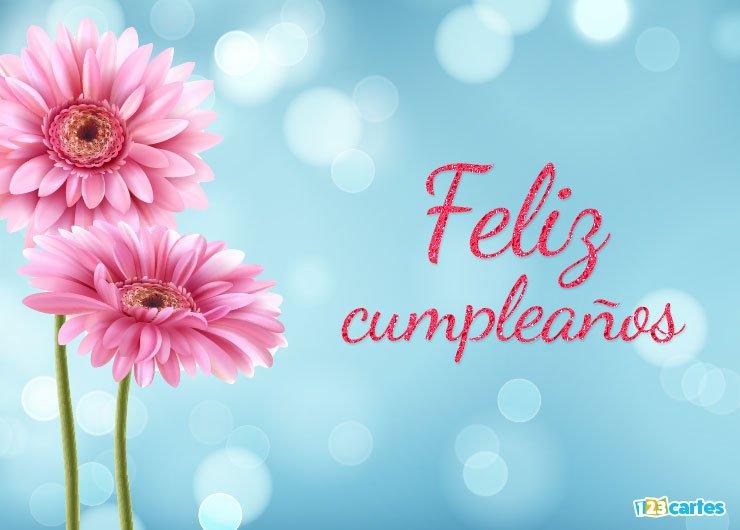 fleur de gerbera rose avec joyeux anniversaire en Espagnol