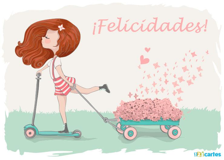 élégante fille sur une trottinette qui tire un petit chariot rempli de roses avec joyeux anniversaire en Felicidades Espagnol