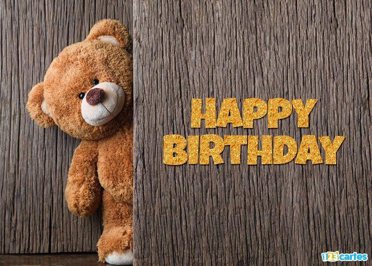 mignon ours en peluche se cache derrière une porte avec joyeux anniversaire en Anglais