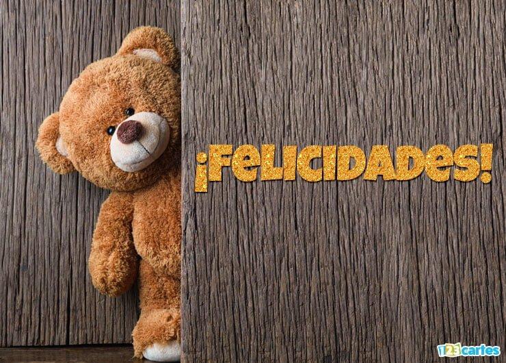 mignon ours en peluche se cache derrière une porte avec joyeux anniversaire en Felicidades Espagnol