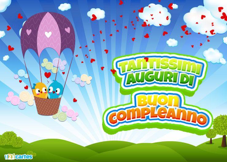 deux petits oiseaux amoureux dans une montgolfière avec joyeux anniversaire en Italien