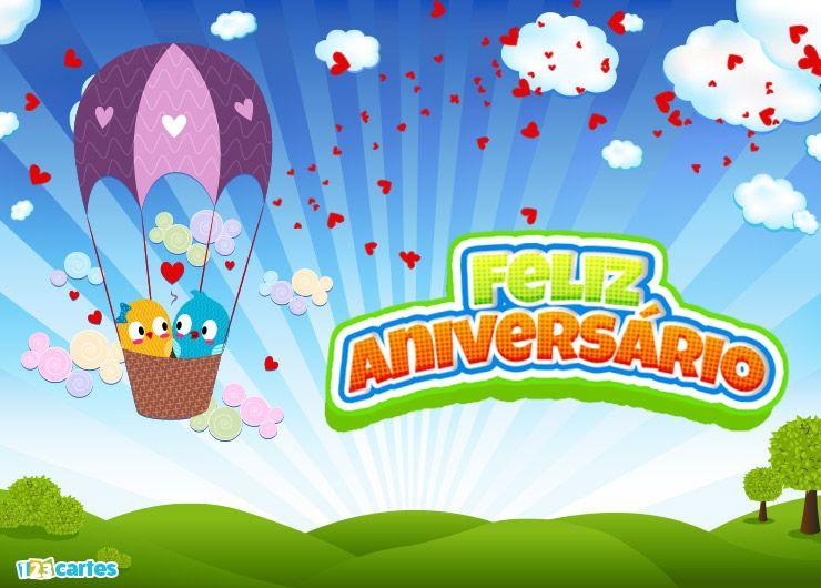 deux petits oiseaux amoureux dans une montgolfière avec joyeux anniversaire en Portugais