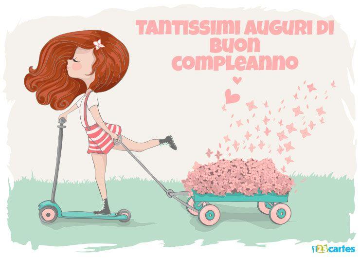 élégante fille sur une trottinette qui tire un petit chariot rempli de roses avec joyeux anniversaire en Italien
