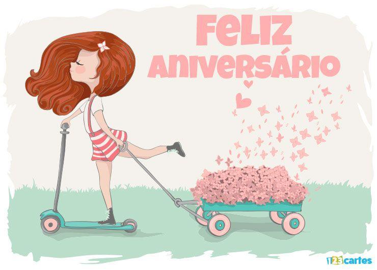 élégante fille sur une trottinette qui tire un petit chariot rempli de roses avec joyeux anniversaire en Portugais