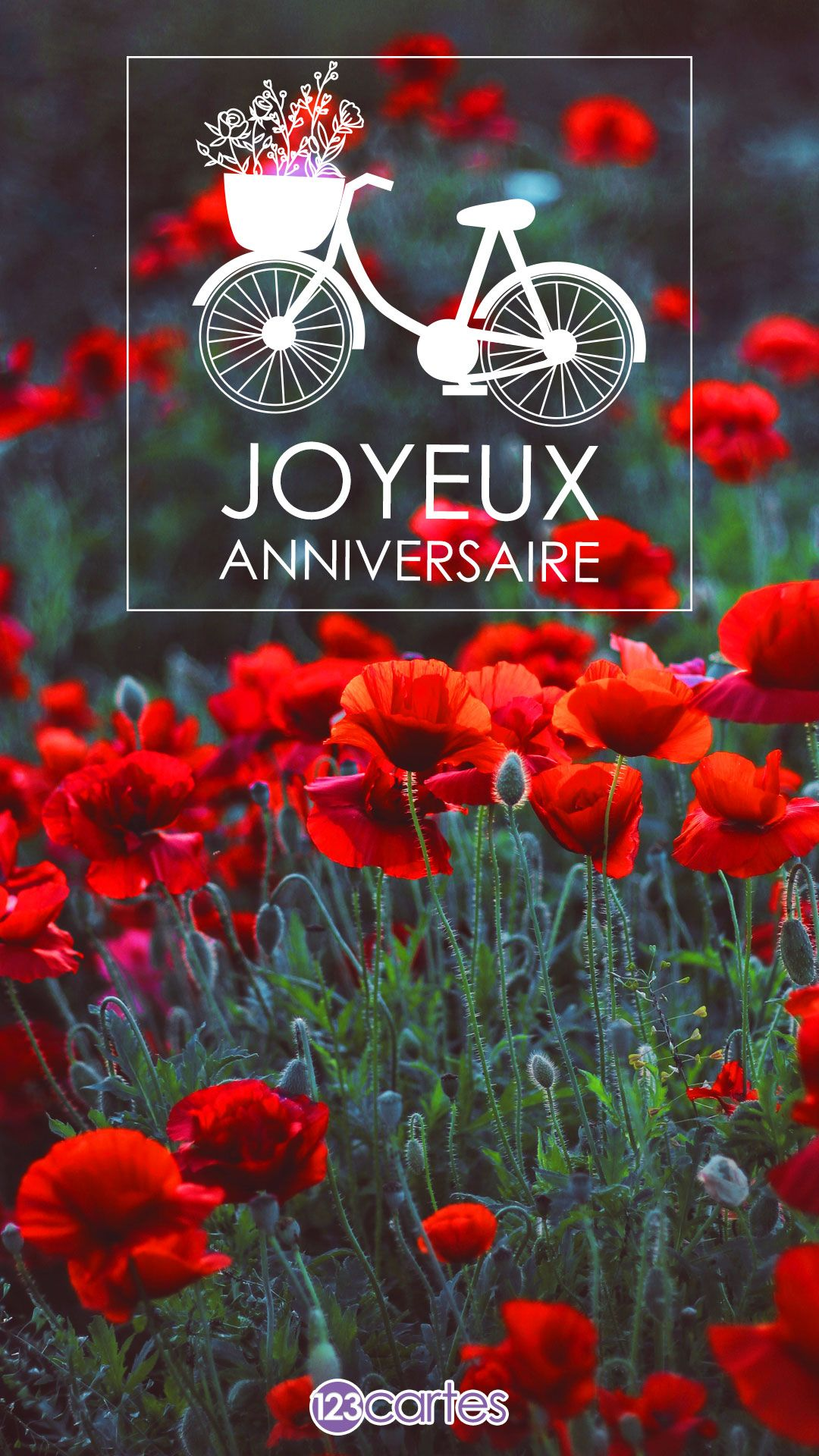 Pré avec des fleurs rouges et le texte joyeux anniversaire avec un ornement en forme de bicyclette