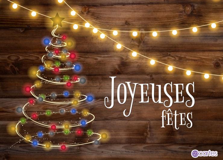 arbre lumineux, guirlandes lumineuses sur un fond en bois - joyeuses fêtes