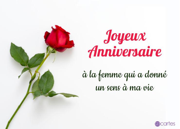rose rouge avec sa tige et un joli texte pour souhaiter joyeux anniversaire à une femme
